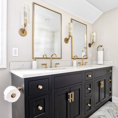 Example of a large transitional master marble tile marble floor and white floor alcove shower design in New York with beaded inset cabinets, black cabinets, an undermount sink, quartz countertops, a hinged shower door and white countertops