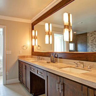Inspiration for a mid-sized transitional master gray tile and mosaic tile ceramic tile bathroom remodel in San Diego with an undermount sink, shaker cabinets, medium tone wood cabinets, limestone countertops and gray walls