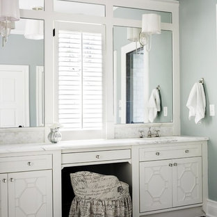 Inspiration for a large timeless master marble floor bathroom remodel in Atlanta with marble countertops, white cabinets and blue walls