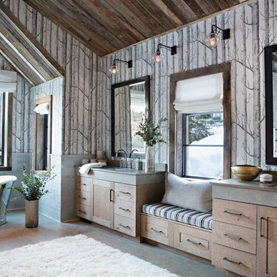 Inspiration for a rustic master freestanding bathtub remodel in Birmingham with medium tone wood cabinets, multicolored walls and an undermount sink