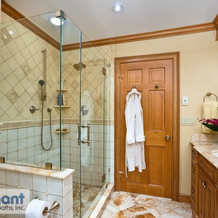 Traditional bathroom in Other with an undermount sink, medium wood cabinets, onyx benchtops, an alcove shower, white tile, ceramic tile and beige walls.