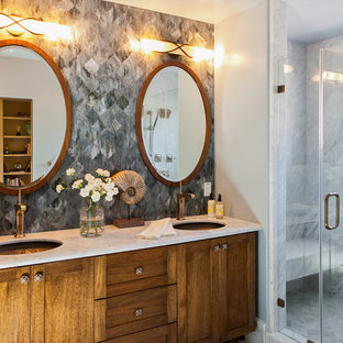 Alcove shower - small transitional gray tile and stone tile alcove shower idea in San Francisco with an undermount sink, shaker cabinets, medium tone wood cabinets and marble countertops