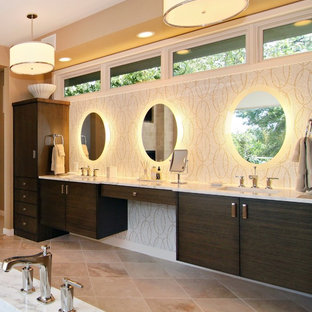 This is an example of a large contemporary ensuite bathroom in Minneapolis with mosaic tiles, flat-panel cabinets, dark wood cabinets, beige walls, travertine flooring, an integrated sink and marble worktops.