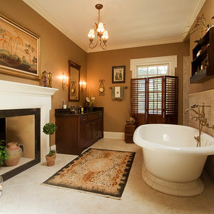 Freestanding bathtub - mid-sized traditional master beige tile and ceramic tile ceramic tile and beige floor freestanding bathtub idea in Chicago with shaker cabinets, dark wood cabinets, beige walls, an undermount sink and granite countertops