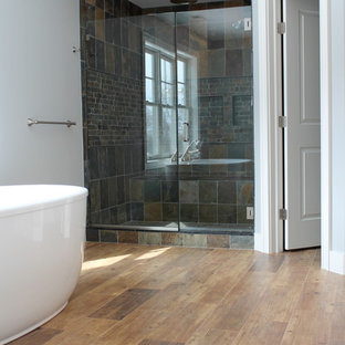 Freestanding bathtub - contemporary master wood-look tile and multicolored tile ceramic floor freestanding bathtub idea in New York with blue walls