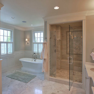 Bathroom - large traditional master white tile and stone slab marble floor and gray floor bathroom idea in DC Metro with an undermount sink, recessed-panel cabinets, white cabinets, granite countertops, a one-piece toilet, green walls, a hinged shower door and beige countertops