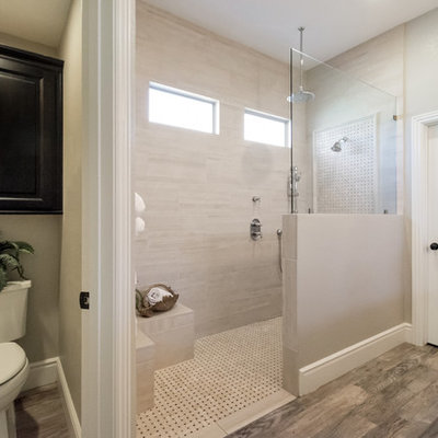 Inspiration for a mid-sized timeless master beige tile and porcelain tile porcelain tile and gray floor bathroom remodel in Phoenix with black cabinets, a one-piece toilet, gray walls, a drop-in sink and quartzite countertops