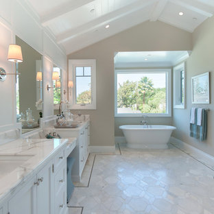 Inspiration for a large timeless master white tile and stone tile marble floor bathroom remodel in Los Angeles with an undermount sink, shaker cabinets, white cabinets, marble countertops, a two-piece toilet and white walls