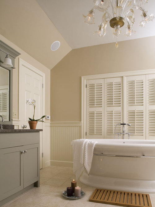 Example Of A Classic Beige Tile Freestanding Bathtub Design In Boston With  Gray Cabinets