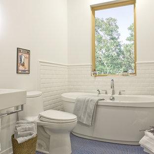 Example of a transitional blue floor freestanding bathtub design in Boston