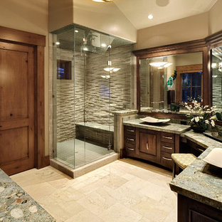 Photo of a traditional bathroom in Salt Lake City with a vessel sink, green benchtops and a shower seat.