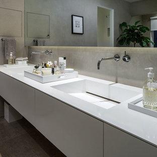Bathroom - scandinavian ceramic tile bathroom idea in Portland with flat-panel cabinets, white cabinets, beige walls and quartz countertops