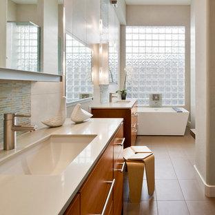 Mid-sized trendy master porcelain tile porcelain tile and beige floor freestanding bathtub photo in Phoenix with quartz countertops, an undermount sink, flat-panel cabinets, medium tone wood cabinets, beige walls and beige countertops