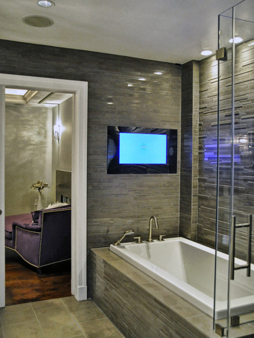 tv in bathroom. inspiration for a large contemporary master brown tile and porcelain floor drop-in tv in bathroom