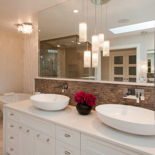 Example of a large trendy brown tile bathroom design in Vancouver with a vessel sink, recessed-panel cabinets and white cabinets