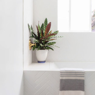 Small beach style master white tile and subway tile mosaic tile floor and white floor bathroom photo in Los Angeles with furniture-like cabinets, blue cabinets, a one-piece toilet, white walls, an undermount sink, marble countertops and white countertops