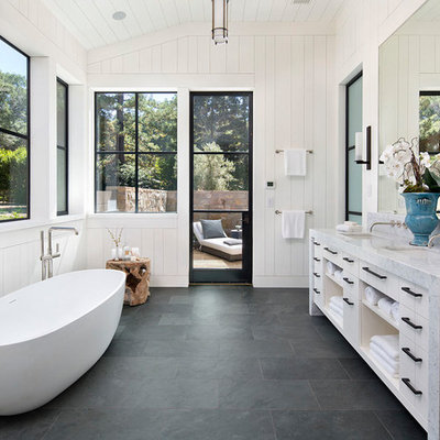 Inspiration for a farmhouse master gray floor and slate floor freestanding bathtub remodel in San Francisco with open cabinets, white cabinets, white walls, an undermount sink and marble countertops