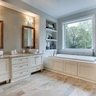 Esempio di una grande stanza da bagno padronale classica con lavabo a bacinella, ante con riquadro incassato, ante bianche, top in marmo, vasca da incasso, doccia alcova, piastrelle marroni, piastrelle di vetro, pareti grigie e pavimento con piastrelle in ceramica