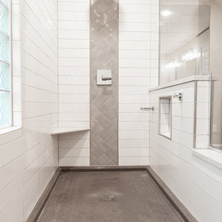 Example of a master white tile and ceramic tile porcelain floor and gray floor bathroom design in St Louis with shaker cabinets, gray cabinets, engineered quartz countertops and white countertops