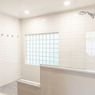 Master white tile and ceramic tile porcelain floor and gray floor bathroom photo in St Louis with shaker cabinets, gray cabinets, engineered quartz countertops and white countertops