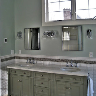 Large transitional master white tile and subway tile porcelain tile bathroom photo with shaker cabinets, gray cabinets, a one-piece toilet, blue walls, an undermount sink and quartz countertops
