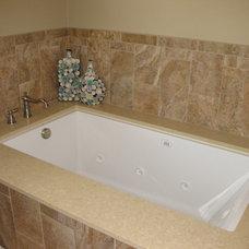 Modern Bathroom by Distinctive Design / Build / Remodel, LLC.