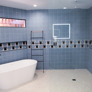 Example of a mid-sized minimalist master blue tile and subway tile terrazzo floor and yellow floor bathroom design in Los Angeles with open cabinets, brown cabinets, a one-piece toilet, white walls and a wall-mount sink