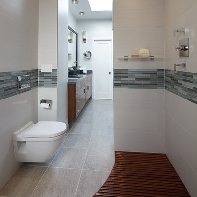Inspiration for a contemporary walk-in shower remodel in Dallas with a wall-mount toilet