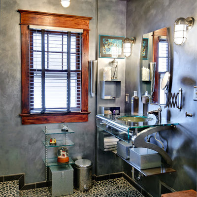 Example of a mid-sized eclectic master pebble tile, black tile and gray tile pebble tile floor alcove shower design in Philadelphia with an undermount sink, glass countertops, gray walls, open cabinets and a one-piece toilet