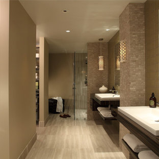 Inspiration for a contemporary bathroom in Atlanta with a drop-in sink, open cabinets, dark wood cabinets, wood benchtops, a curbless shower, beige tile, glass tile, beige walls and travertine floors.