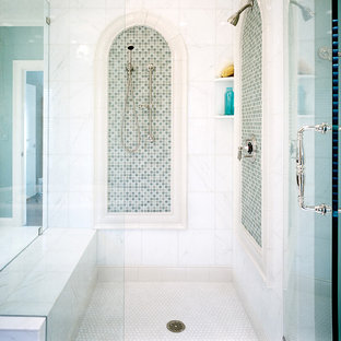 Inspiration for a mediterranean bathroom in Other with a corner shower, glass tiles, mosaic tile flooring and green tiles.