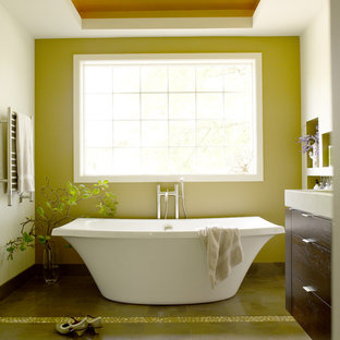 Inspiration for a contemporary bathroom in Seattle with flat-panel cabinets, dark wood cabinets, a freestanding bath, green walls and brown floors.