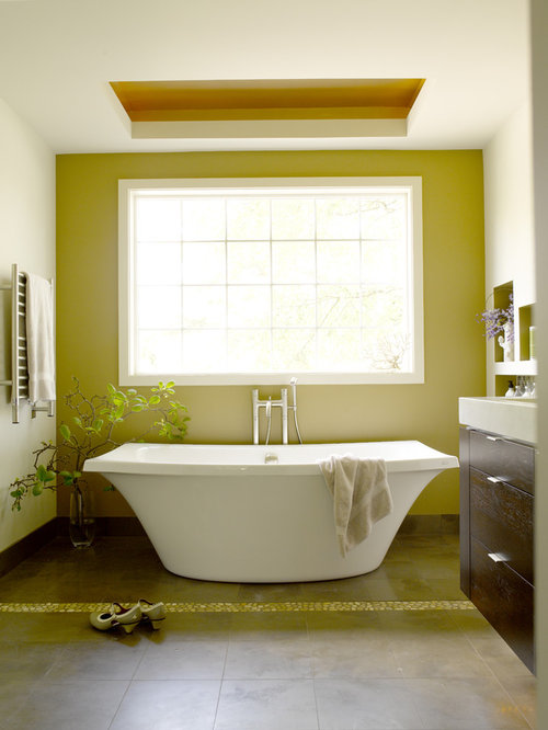 Contemporary Brown Floor Freestanding Bathtub Idea In Seattle With  Flat Panel Cabinets, Dark Wood