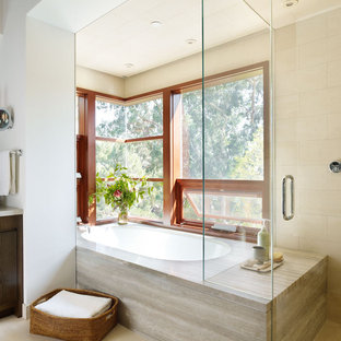 Minimalist beige tile bathroom photo in Los Angeles with an undermount tub