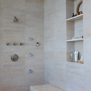 Inspiration for a contemporary beige tile pebble tile floor bathroom remodel in Los Angeles