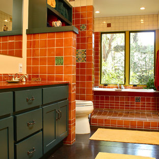 Southwest red tile bathroom photo in Santa Barbara with shaker cabinets and blue cabinets