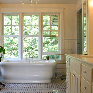 Elegant mosaic tile freestanding bathtub photo in San Francisco