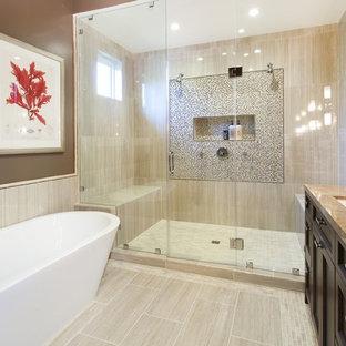 サンフランシスコの中サイズの地中海スタイルのおしゃれなマスターバスルーム (置き型浴槽、ベージュの床、落し込みパネル扉のキャビネット、濃色木目調キャビネット、アルコーブ型シャワー、マルチカラーのタイル、モザイクタイル、茶色い壁、磁器タイルの床、アンダーカウンター洗面器、御影石の洗面台、ブラウンの洗面カウンター) の写真