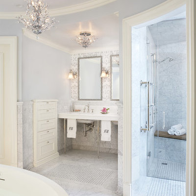 Freestanding bathtub - traditional freestanding bathtub idea in Chicago with a console sink