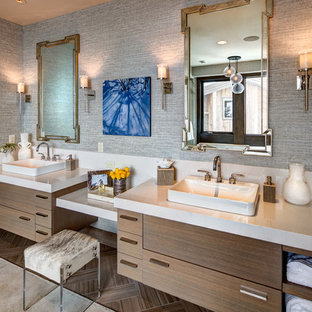 Design ideas for a large country master bathroom in Salt Lake City with flat-panel cabinets, medium wood cabinets, grey walls, ceramic floors, granite benchtops, brown floor, a vessel sink and grey benchtops.