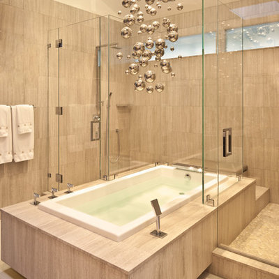 Inspiration for a mid-sized contemporary master beige tile and porcelain tile beige floor bathroom remodel in Los Angeles with beige walls and a hinged shower door