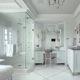 Bathroom - mid-sized transitional master white tile ceramic floor and white floor bathroom idea in New York with flat-panel cabinets, white cabinets, a one-piece toilet, white walls, an undermount sink, marble countertops, a hinged shower door and gray countertops