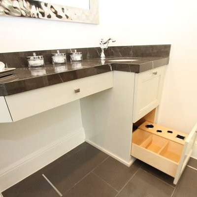 Bathroom - small transitional master black tile and porcelain tile porcelain tile bathroom idea in Austin with an undermount sink, flat-panel cabinets, white cabinets, marble countertops and white walls