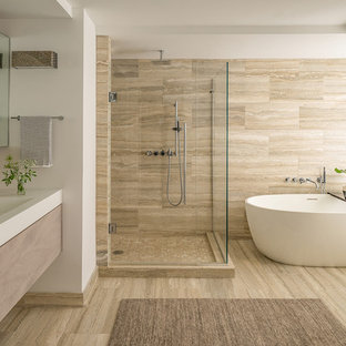 Example of a large minimalist master bathroom design in Boston with flat-panel cabinets, light wood cabinets, brown walls, a wall-mount sink, quartz countertops, a hinged shower door, white countertops and a floating vanity