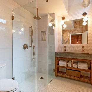 Master bathroom with curbless, open shower and concrete trough sink