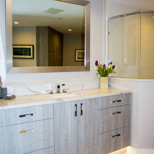 Large trendy master white tile double shower photo in Tampa with flat-panel cabinets, gray cabinets, a drop-in sink and quartz countertops