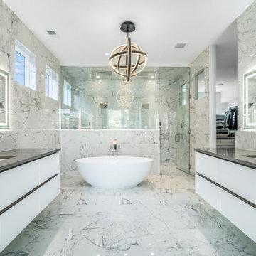 Master bathroom with open walk in closet