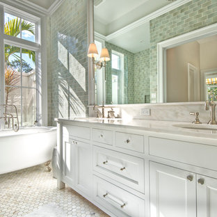 Bathroom - mid-sized traditional master green tile and ceramic tile mosaic tile floor bathroom idea in Tampa with a two-piece toilet, beige walls, an undermount sink, marble countertops, furniture-like cabinets and white cabinets