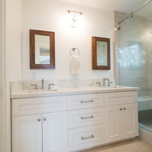 Mid-sized transitional master gray tile and subway tile porcelain tile and beige floor bathroom photo in Los Angeles with white cabinets, beaded inset cabinets, a two-piece toilet, white walls, an undermount sink, quartzite countertops and white countertops