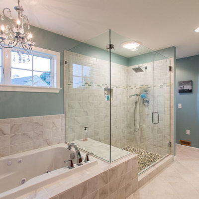 Mid-sized elegant master ceramic tile and beige tile ceramic tile and beige floor bathroom photo in Philadelphia with green walls, raised-panel cabinets, dark wood cabinets, an undermount sink and a hinged shower door